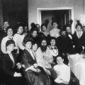 Rasputin and his admirers, 1914. His telephone can be seen on the right.